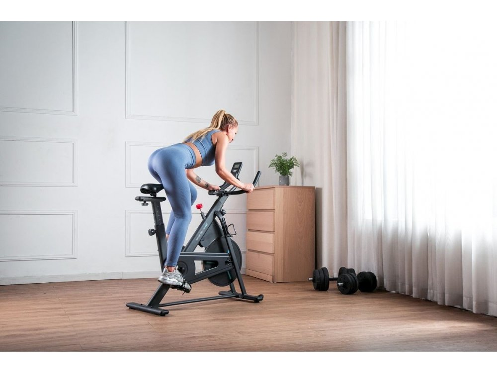 OVICX XCycle Q100C Spinning Bike, Stationary, With LCD Screen, Adjustable Seat and Handlebar